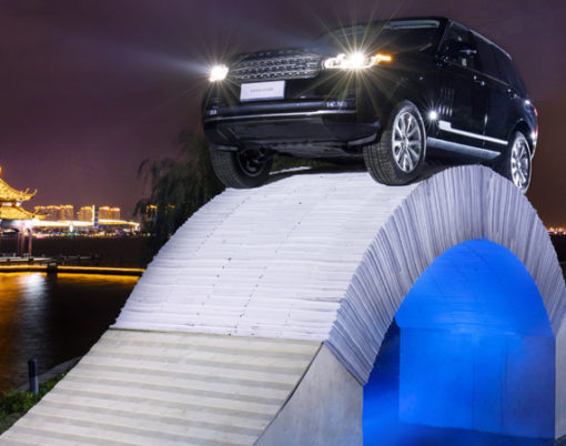 Land Rover continues with brand firsts with paper bridge stunt.