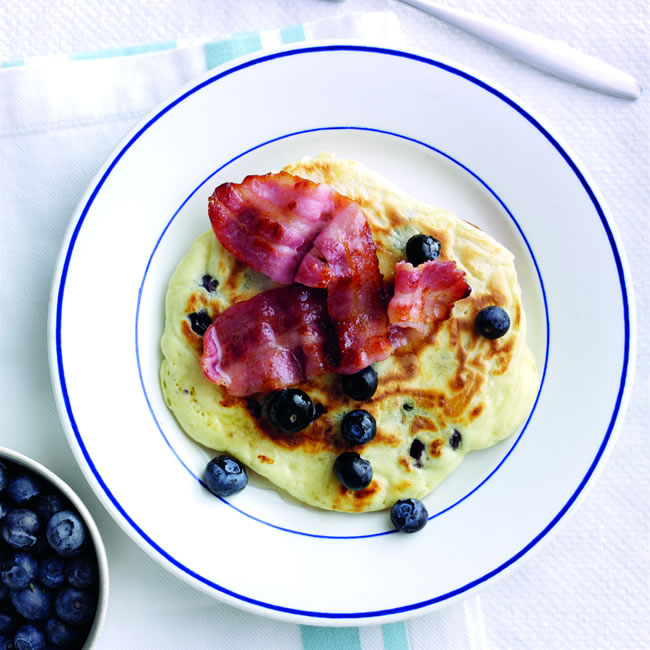 Blueberry feta hotcakes with bacon and honey