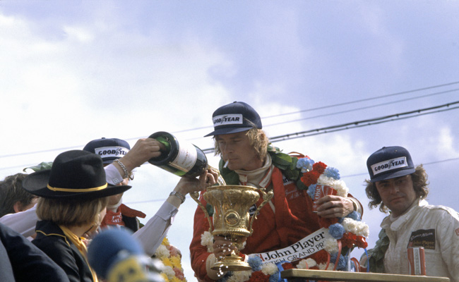 Silverstone, England. 14th - 6th July 1977. James Hunt (McLaren M26-Ford) wins the British Grand Prix with with Niki Lauda (Ferrari 312T2) in 2nd. Photo Credit: Silverstone Classic/LAT Photographic www.latphoto.co.uk
