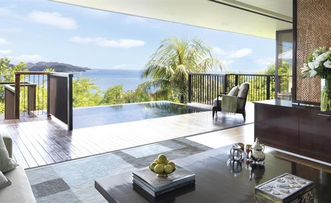 Each villa at Raffles Seychelles offers a private plunge pool and outdoor pavilion to soak up breathtaking views of the opal-hued ocean, white sandy beach and lush green hills