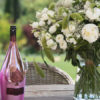Table Setting + Rose_ Credit Getty + Champagne Armand de Brignac