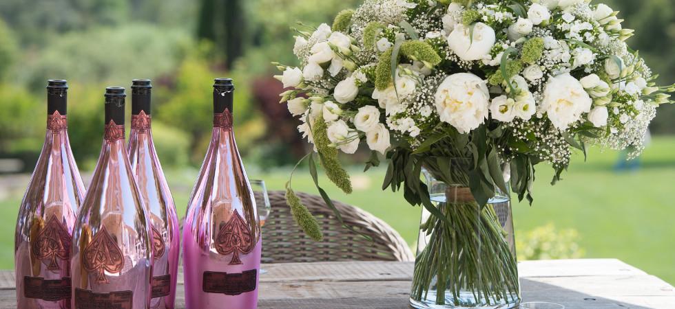 Table Setting + Rose_ Credit Getty + Champagne Armand de Brignac