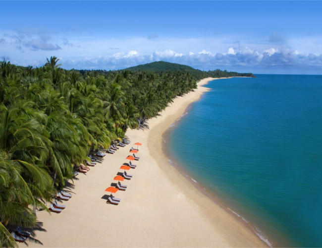 Enjoy a romantic stroll along Santiburi Beach Resort & Spa's beach.