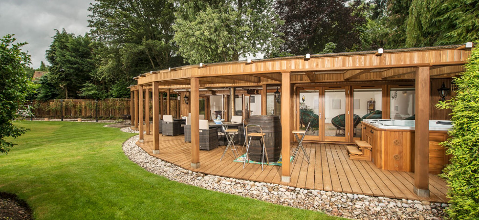 Bringing the inside outside with crown pavilions luxury for Luxury garden sheds