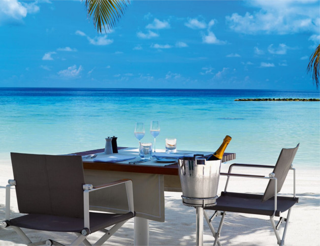 Relax and unwind on the white sands of Velaa Private Island resort.