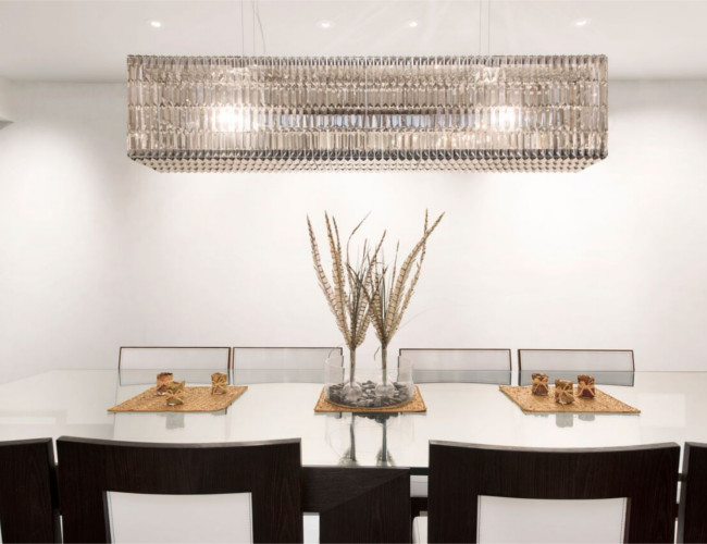 Stylist dining room featuring the Swarovski crystal chandelier.