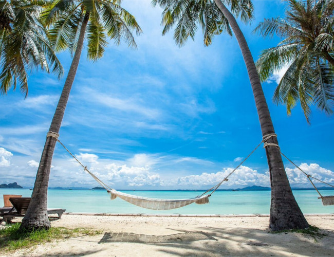 Relax on the white sand beach at Phi Phi Island Village Beach Resort.