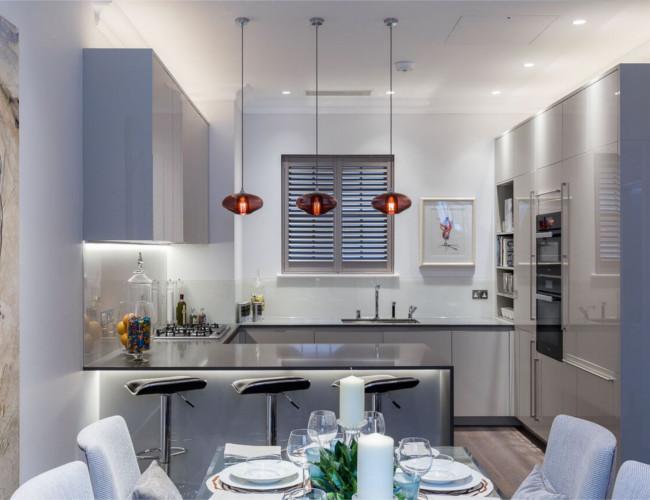 The sleek, modern kitchen of the luxurious Mews House.