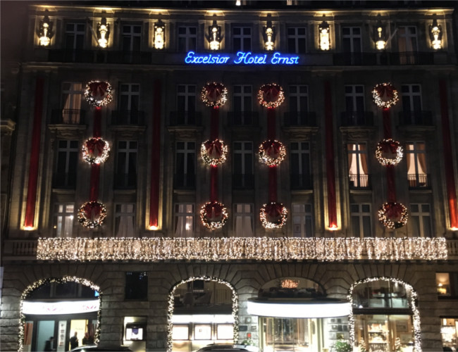 The sparkling Christmas lights of the Excelsior Hotel Ernst's exterior.