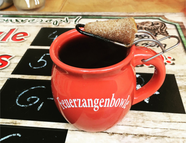 Traditional German beverage called Feuerzangenbowle sold at the Christmas markets.