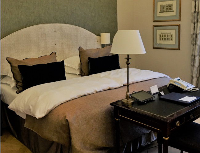 Our Grand Deluxe Room, featuring polished mahogany desk and sketch of Chatsworth House.