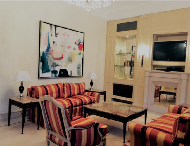 A stylish suite living room featuring an example of the much loved pop art in Cologne.