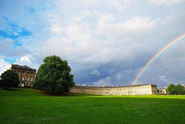 A view of the Royal Crescent in Bath with a rainbow overhead