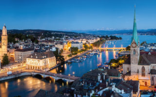 Zurich by night with panoramic view over the whole lake basin.