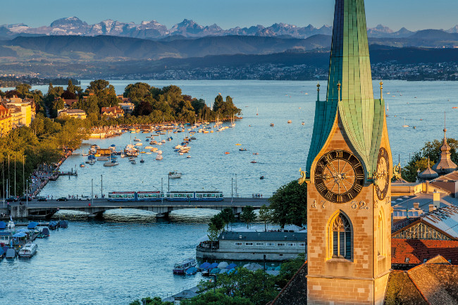 Zurich with view of Quaibruecke and Alps.