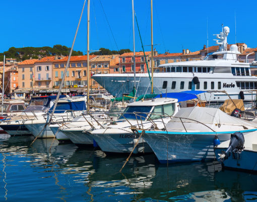 Saint Tropez France - August 03 2016: view in the harbor of Saint Tropez. St Tropez is a seaside resort at the Cote dAzur and popular for the European and American jet set