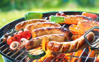 Grilled sausage on the picnic flaming grill