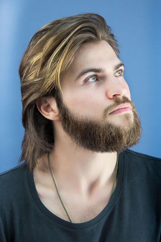 Men's hairstyles are shifting from fades and tapers to soft, longer looks