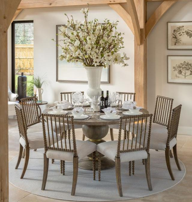These elegant bobbin chairs and dining table by julian chichester rest serenely beneath the high vaulted oak beams of our rustic surrey barn project