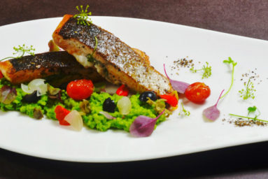 AQUA – salmon with green pea mash, onion hollandaise