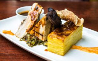 Braised pork belly, jerk pork ribs potato gratin, coconut puree and callaloo
