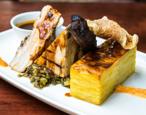 Braised pork belly, jerk pork ribs potato gratin, coconut puree and callaloo