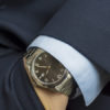 Hand in pocket with wrist watch in a business suit close up