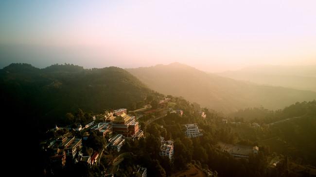 Orange sunrise above mountain in valley Himalayas mountains