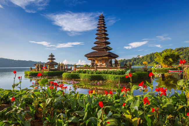 Pura Ulun Danu Bratan Bali. Hindu temple surrounded by flowers on Bratan lake Bali. Major Shivaite water temple in Bali Indonesia. Water temple in Bali Indonesia. Hindu temple of Bali Indonesia