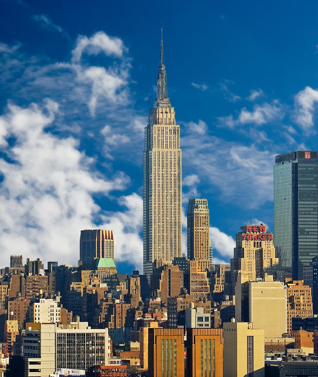 Empire State Building and Midtown Manhattan against blue sky