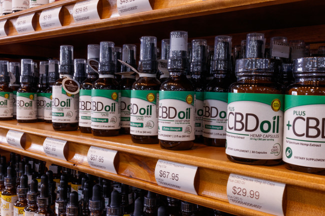 Indianapolis - Circa February 2019: Various CBD oil products. The popularity of CBD oil as a medicinal product has skyrocketed IV
