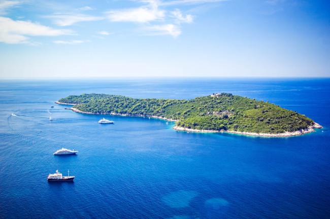 Panoramic view of Lokrum Island Dalmatian Coast of Adriatic Sea in Dubrovnik. Blue sea with white yachts, beautiful landscape, aerial view, Dubrovnik, Croatia