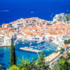 Panoramic view of Old Town (medieval Ragusa) and Dalmatian Coast of Adriatic Sea in Dubrovnik. Blue sea with white yachts, beautiful landscape, aerial view, Dubrovnik, Croatia