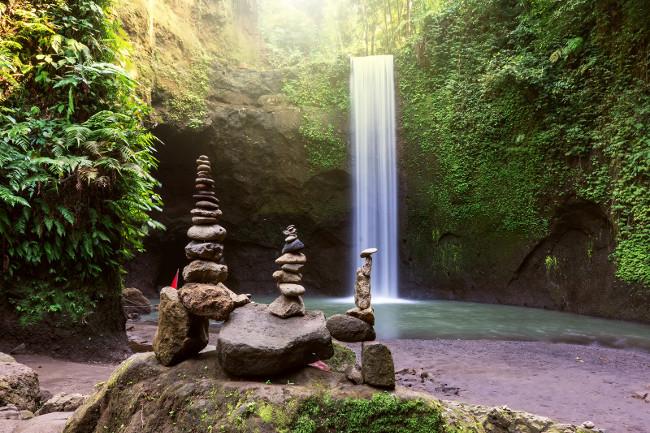 Stacked zen stone at Tibumana Waterfall in Ubud Bali Indonesia.