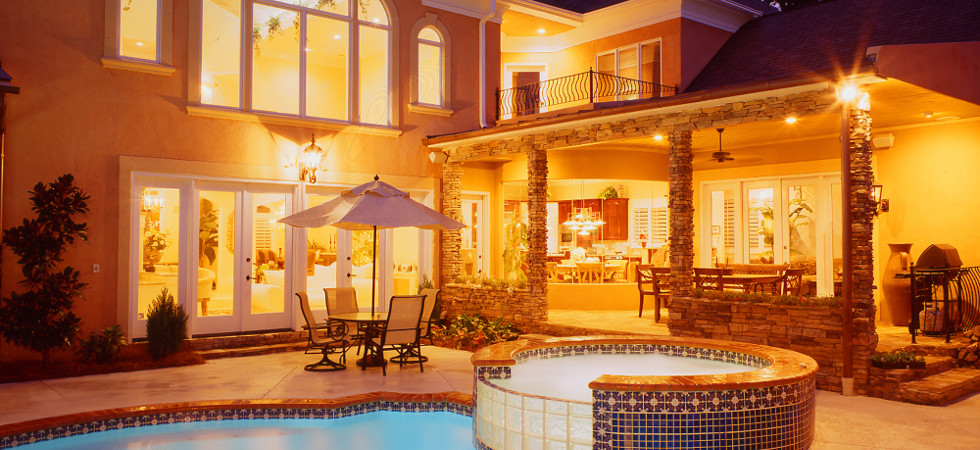 Nice exterior of luxoury home taken at sunset with hot tub