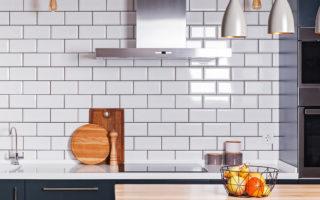 Modern interior. Spacious kitchen with white brick tile wall.