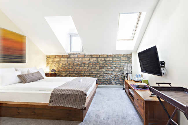 Bedroom interior in luxury loft, attic, apartment with roof windows - Hotel room - vacation concept background