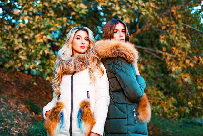 Fashionable ladies wearing fur style clothing for outside. Autumn fashion trend. Fashion outdoor photo of gorgeous sensual models in elegant luxurious coat