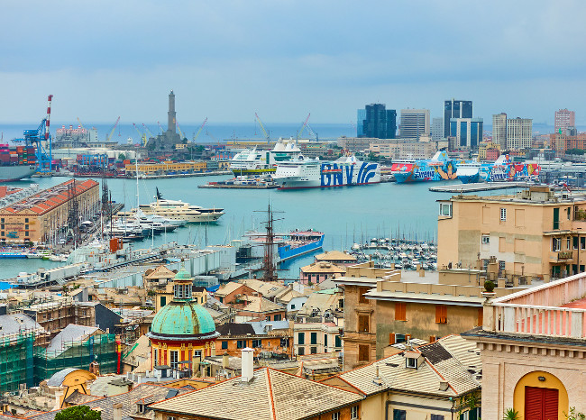 Genoa (Genova), Italy - July 7, 2019:  Panoramic view of the Genoa Port with cruise ships, yachts, and boats