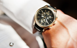 Hai Ukraine - January 5 2017: Man looking on luxury watches Rolex on his hand.