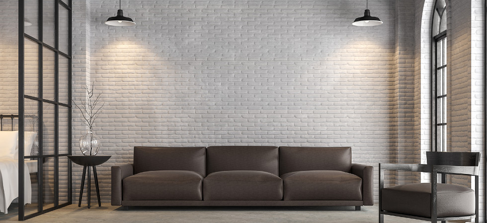 Loft living room and bedroom 3d render,There are white brick wall,polished concrete floor.Furnished with dark brown leather sofa ,There are arch shape windows sunlight shining into the room.