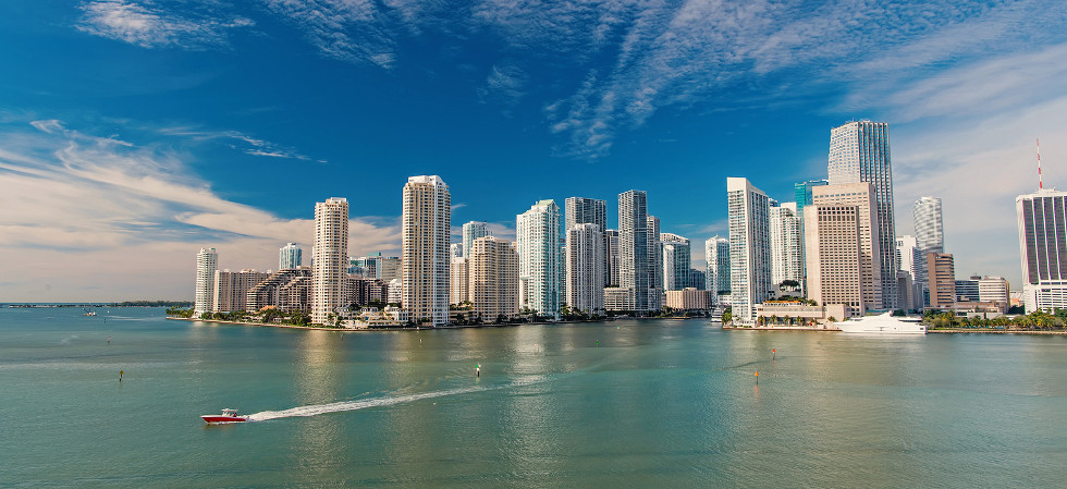 Miami skyline skyscrapers , yacht or boat next to Miami downtown, Aerial view, south beach. Miami
