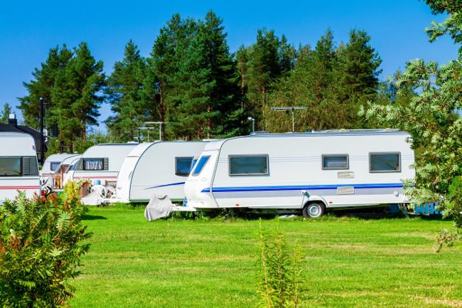 Modern luxury mobile homes in a caravan park.