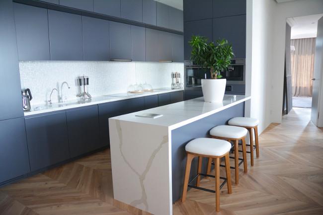 Modern kitchen interior design with hardwood floors in luxury home
