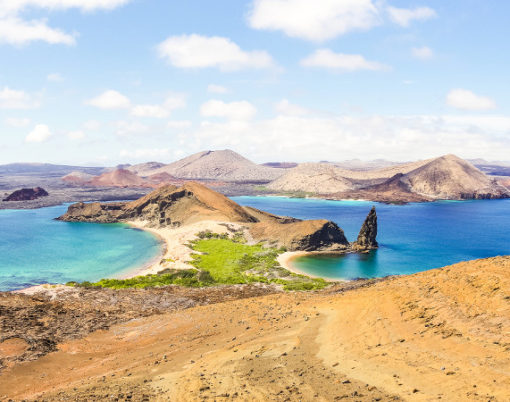 "Panoramic view of "" Isla Bartolome "" at Galapagos Islands archipelago - Travel and wanderlust concept exploring world nature wonders around Ecuador - Vivid filter with warm bright color tones"