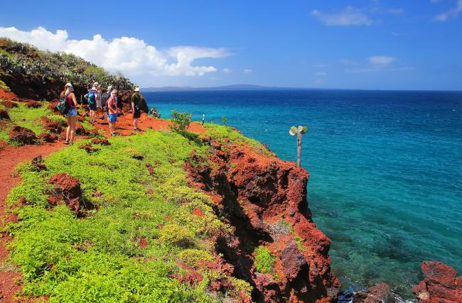 RABIDA ISLAND, ECUADOR -APRIL 22: Unidentified people visit Rabida Island on April 22, 2015 in Galapagos National Park, Ecuador. Galapagos Islands are UNESCO World Heritage Site