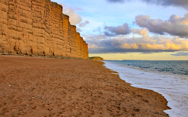The sandstone cliffs at West Bay in Dorset, England. This is part of the Jurassic coast which runs from Exmouth in Devon to Studland Bay in Dorset, a distance of 96 miles