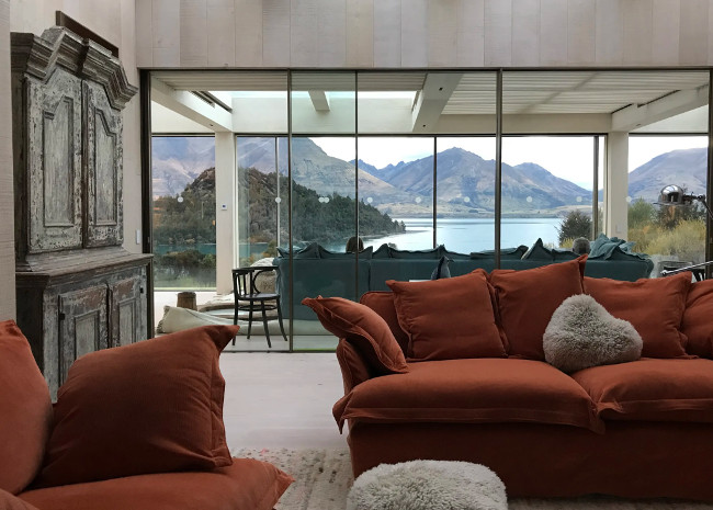 Living room with view of lake and mountains