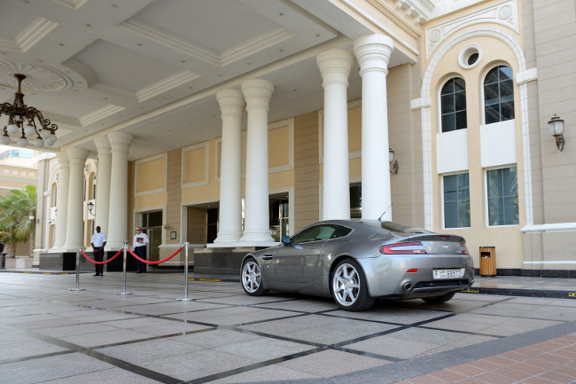 DUBAI, UAE - SEPTEMBER 11: The Westin hotel and Aston Martin Vantage sport car on September 11, 2013 in Dubai, UAE. Over 11 million tourist visited hotels in Dubai in year 2013.
