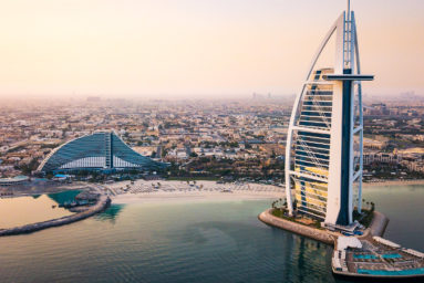 Dubai, United Arab Emirates - June 5, 2019: Dubai seaside skyline and Burj Al Arab luxury hotel aerial view at sunrise